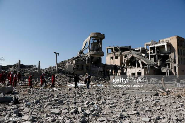 Rescue workers search for victims of airstrikes on a prison carried out by warplanes with the Saudi-led coalition September 01, 2019 in Dhamar...