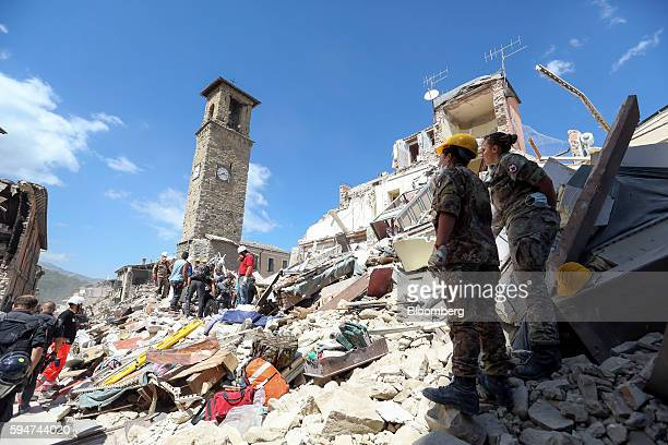 Rescue workers search in the rubble for survivors following an earthquake in Amatrice Italy on Wednesday Aug 24 2016 A powerful earthquake hit...