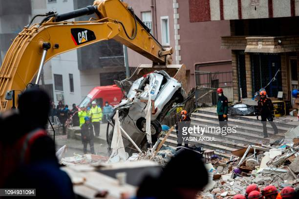 Rescue workers search the rubble of an eightstorey building which collapsed the previous day in the Kartal district of the Turkish city of Istanbul...