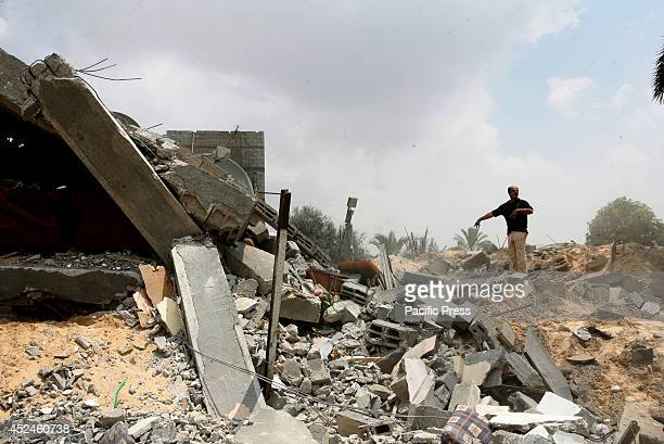 Rescue workers search the rubble of Palestinian homes after an Israeli air strike on Khan Yunis in the southern Gaza strip. The death toll in Gaza...