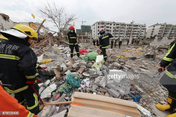 Rescue workers search the site of an explosion in Ningbo China's eastern Zhejiang province on November 26 2017 A major explosion hit China's eastern...