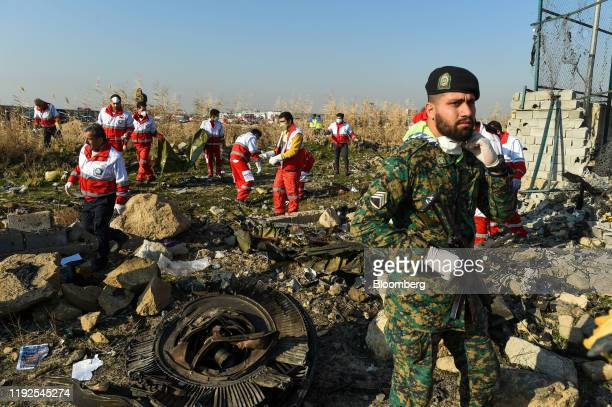 Rescue workers search the wreckage of a Boeing Co 737800 aircraft operated by Ukraine International Airlines which crashed shortly after takeoff near...