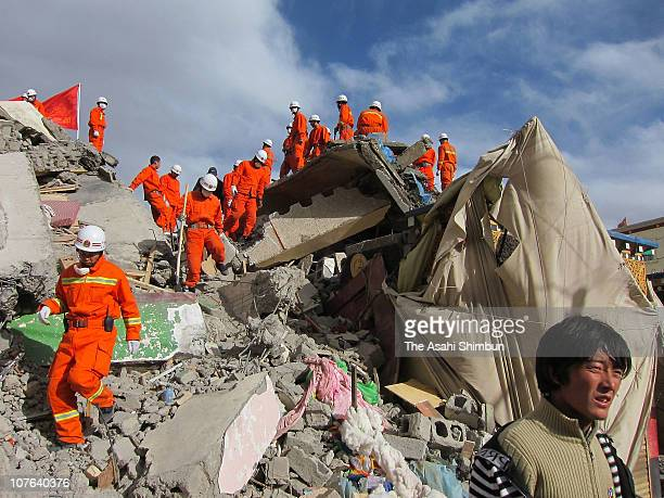 Rescue workers search through debris for survivors on April 15, 2010 in Yushu county, Qinghai, China. Thousands of rescuers fought against time on...