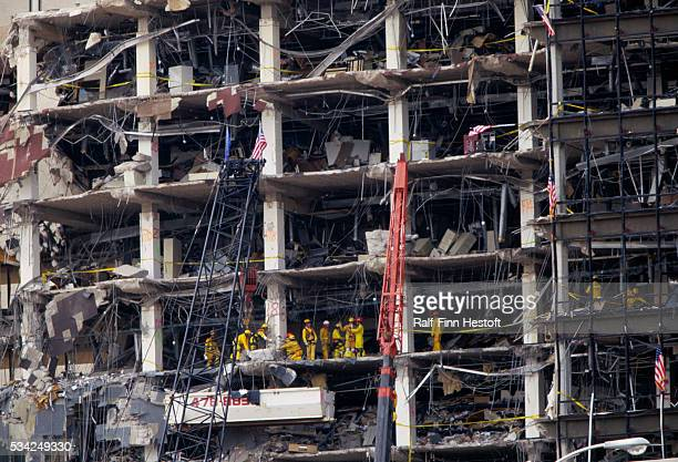 Rescue workers sift through the rubble of the destroyed Federal Building in the aftermath of the Oklahoma City bombing On April 19th a...