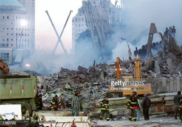 Rescue workers sift through the wreckage of the World Trade Center September 13, 2001 in New York City, two days after the twin towers were destroyed...