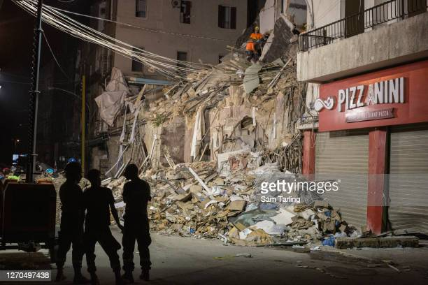 Rescue workers sort through rubble to find a potential survivor 30 days after the explosion in Beirut port, on September 3, 2020 in Beirut, Lebanon....