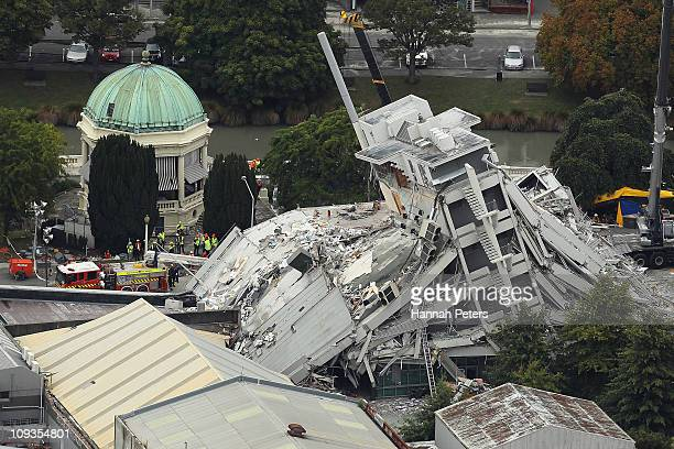 Rescue workers surround the Pyne Gould Guiness building on February 23, 2011 in Christchurch, New Zealand. A massive search and rescue mission is...