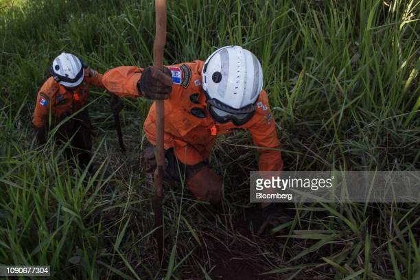 Rescue workers survey damage after a Vale SA dam burst in Brumadinho, Minas Gerais state, Brazil, on Monday, Jan. 28, 2019. Vale's dam breach has...