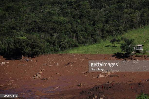 Rescue workers survey damage after a Vale SA dam burst in Brumadinho Minas Gerais state Brazil on Monday Jan 28 2019 Vale's dam breach has left at...