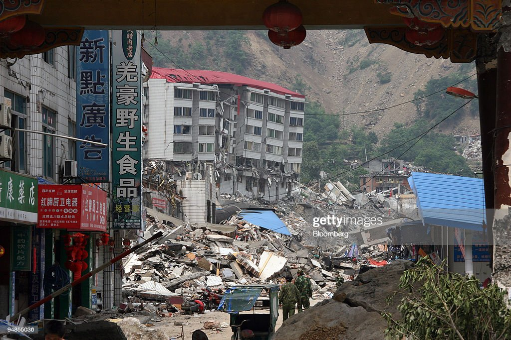 Rescue workers survey the destruction from an earthquake in : News Photo