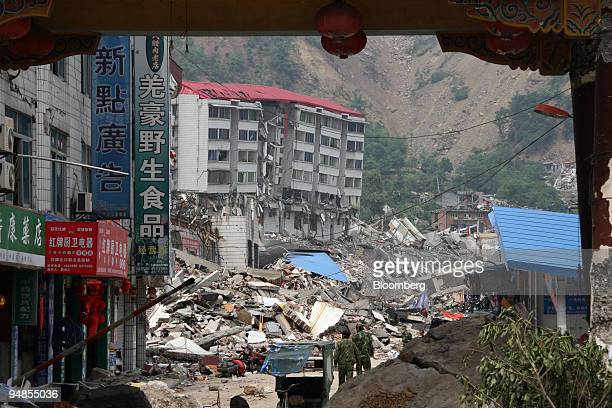 Rescue workers survey the destruction from an earthquake in Beichuan Sichuan Province China on Friday May 16 2008 Two US military transport planes...
