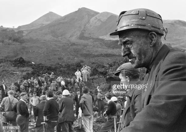 Rescue workers take a break from searching following the catastrophic collapse of a colliery spoil tip in the Welsh village of Aberfan near Merthyr...