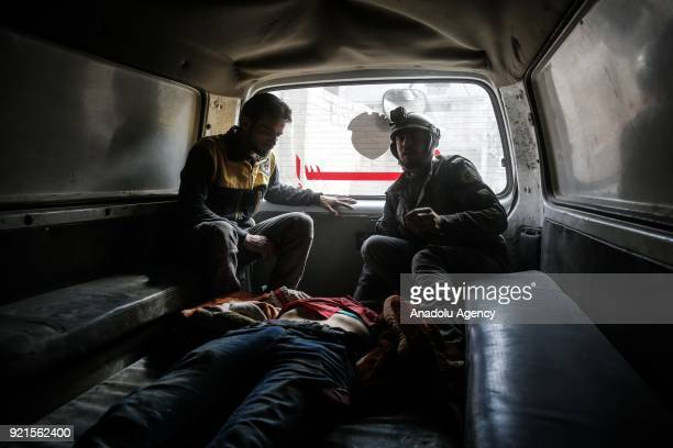 Rescue workers take a wounded man to the hospital after Assad Regime carried out an airstrike over Sakba town of Eastern Goutha region which is a...