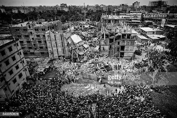 Rescue workers take part in the rescue of the eightstorey building Rana Plaza which collapsed at Savar Dhaka Bangladesh April 25 2013