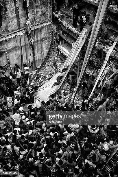 Rescue workers take part in the rescue of the eightstorey building Rana Plaza which collapsed at Savar Dhaka Bangladesh 25 April 2013 Reports state...