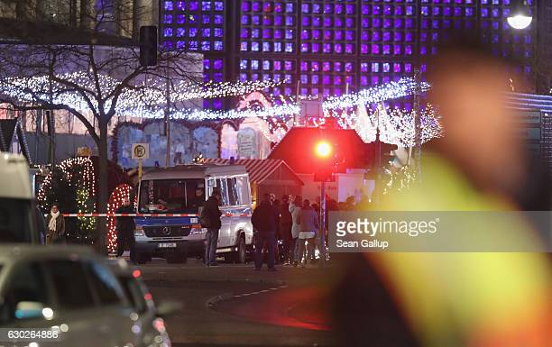 Rescue workers tend to the area after a lorry truck ploughed through a Christmas market on December 19 2016 in Berlin Germany Several people have...