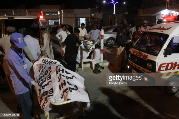 QUETTA BALOCHISTAN PAKISTAN Rescue workers transport the dead bodies of victims to a hospital A suicide bombing attack on Balochistan Awami Party...
