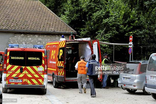 """Rescue workers walk to their van near the """"Cuves de Sassenage"""" cave in Sassenage near Grenoble, central-eastern France, on July 22 where eight """"very..."""