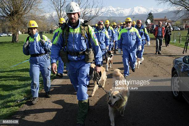 Rescue workers with search and rescue dogs are seen at work on April 7, 2009 in Onna a village near L'Aquila, Italy. On April 6, 2009 the 6.3...