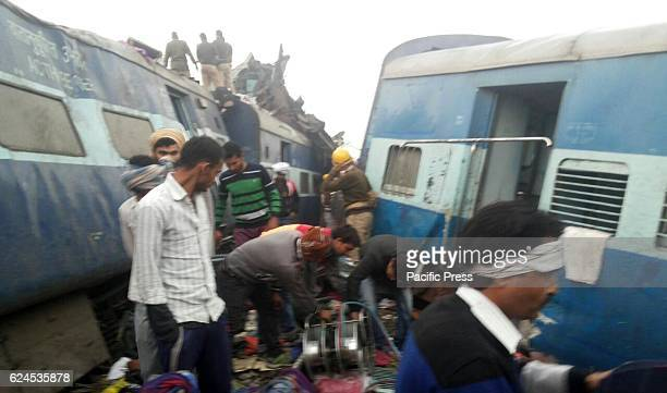 Rescue workers work after IndoreRajendraNager Express derailed at Pokhraya station near Kanpur resulting in the deaths of nearly 100 people