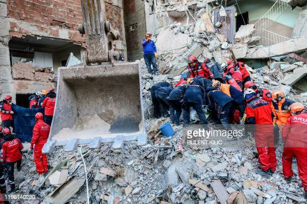 Rescue workers work amid the rubble of a building after an earthquake in Elazig eastern Turkey on January 25 2020 Rescue workers raced against time...