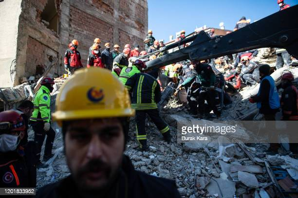 Rescue workers work at the scene of a collapsed building on January 25 2020 in Elazig Turkey The 68magnitude earthquake injured more than 1000 people...
