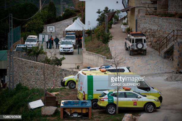 Rescue workers work near the site where a child fell down a well in Totalan southern Spain on January 22 2019 The search for a toddler who fell down...