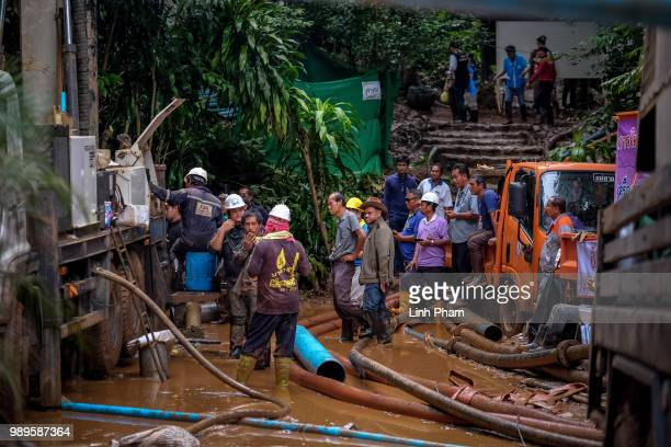 Rescue workers work on the water pumping machine at the entrance of Tham Luang Nang Non cave on July 2 2018 in Chiang Rai Thailand Rescuers from...