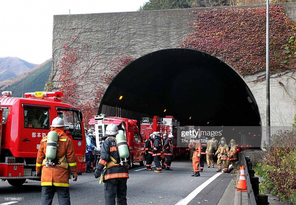 Rescue works continue in the snow at Sasago Tunnel of the Chuo expressway on December 2, 2012 in Otsuki, Yamanashi, Japan. The concrete ceiling panels of the tunnel collapsed more than 110 metres and at least 9 people confirmed dead.