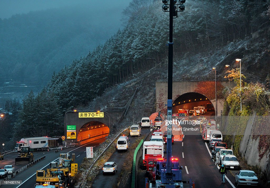 Rescue works continue in the snow at Sasago Tunnel of the Chuo expressway on December 3, 2012 in Otsuki, Yamanashi, Japan. The concrete ceiling panels of the tunnel collapsed more than 110 metres and at least 9 people confirmed dead.