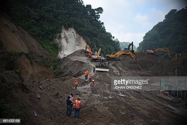 Rescue works restart in Santa Catarina Pinula municipality some 15 km east of Guatemala City on October 5 four days after a deadly landslide struck...