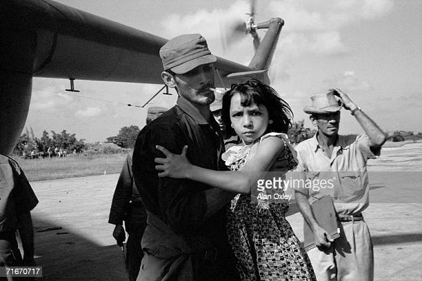 Rescued by helicopter from the flood waters of Hurricane Flora in Eastern Cuba a young girl arrives at a Red Cross shelter in Bayamo 10th October...