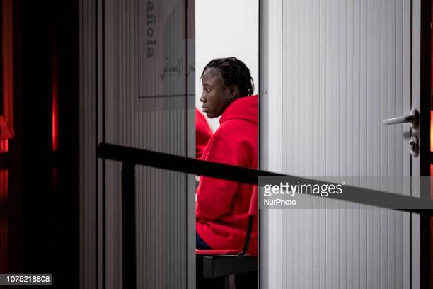A rescued feale migrant waiting inside the Care unit before taking a bus to be transferred to a center on 22 December 2018 in Malaga Spain 120...