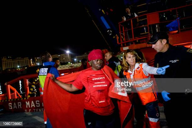 A rescued female migrant being transferred from the vessel to the Red Cross tent On 11 November 2018 in Malaga Spain The Maritime Spanish Vessel SAR...