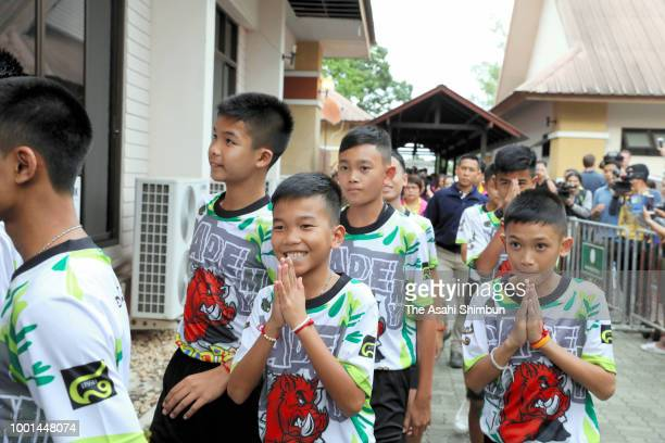 Ekarat Wongsukchan a member of rescued football team 'Wild Boars' is welcomed by his family members on arrival at his home after attending a press...
