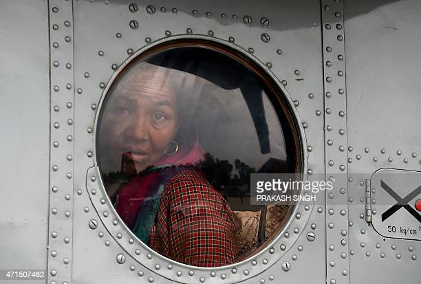 A rescued injured Nepalese women looks out of an Indian Air Force helicopter as she waits to be taken to hospital in Kathmandu on April 29 2015...