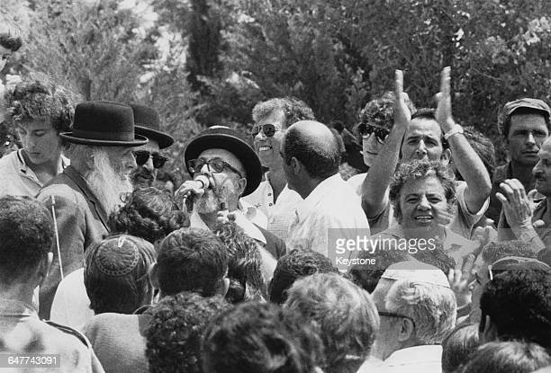 Rescued Israeli hostages being greeted by friends and relatives at Ben Gurion Airport near Tel Aviv on their return to Israel after Operation Entebbe...