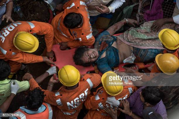 Rescued lady survivor being taken to hospital after a fourstorey building Sai Darshan collapsed fourteen fire engines one rescue van and an ambulance...