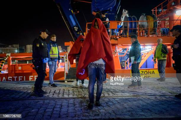 A rescued migrant being transferred from the vessel to the Red Cross tent On 11 November 2018 in Malaga Spain The Maritime Spanish Vessel SAR...
