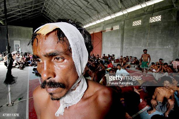 A rescued migrant seen at the new confinement on May 15 2015 in Langsa Indonesia More than 750 Rohingya and Bangladeshi migrants were rescued off...