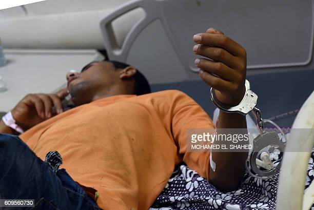 Rescued migrant Wael Mahmoud Mohammed a 19years old student from Dormao Fayoum lies in bed with handcuffs on his wrist at Rashid hospital in Rosetta...