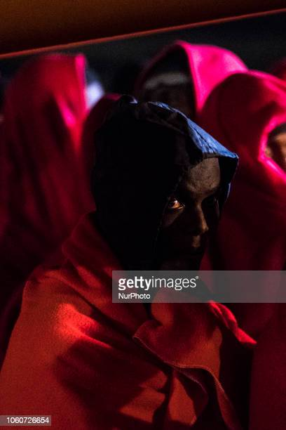 A rescued migrant waiting to be transferred from the vessel to the Red Cross tent On 11 November 2018 in Malaga Spain The Maritime Spanish Vessel SAR...