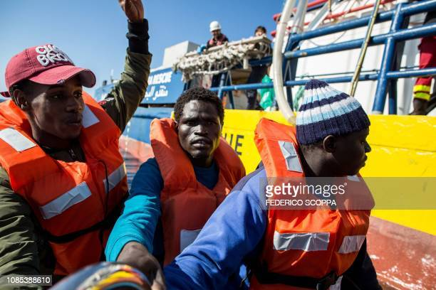 Rescued migrants from a group of 47 are transfered from their rescued unflatable boat onto the Dutch-flagged vessel Sea Watch 3 during a rescue...