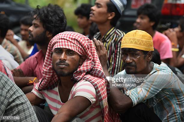 Rescued migrants from Bangladesh wait for an identification process by Indonesian authorities and the International Organization for Migration at the...