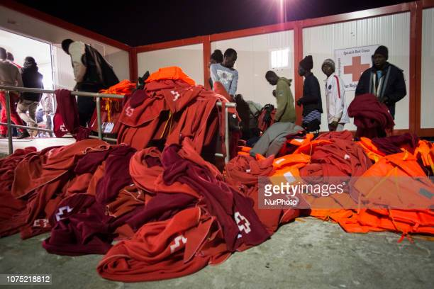 Rescued migrants must leave the cover outside of the Care unit before being attended by the Red Cross staffs on 22 December 2018 in Malaga Spain 120...