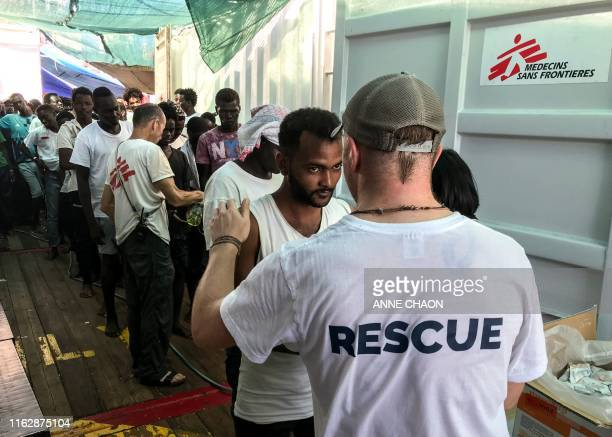 Rescued migrants wait aboard the 'Ocean Viking' rescue ship jointly operated by French NGOs SOS Mediterranee and Medecins sans Frontieres on August...