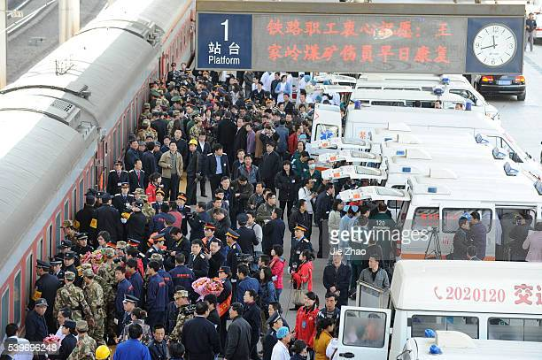 A rescued miner from the flooded Wangjialing Coal Mine is carried out a train to a hospital of Taiyuan to receive medical treatment in Taiyuan Shanxi...