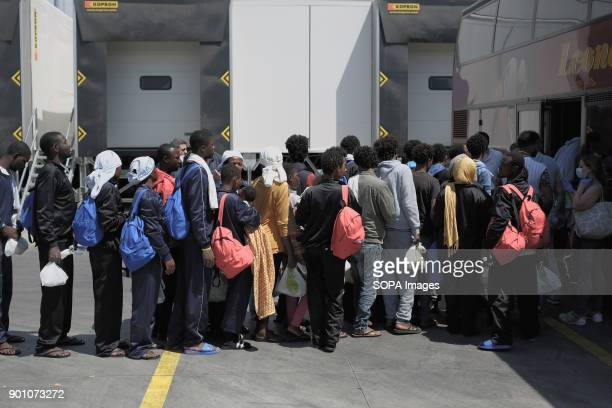 Rescued refugees wait to be moved by bus in different places in the whole Campania region About 1500 african refugees land in Naples from Vos...