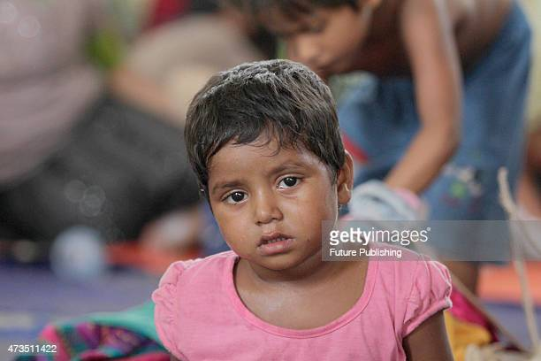 A rescued Rohingya kid migrant seen at the new confinement on May 15 2015 in Langsa Indonesia More than 750 Rohingya and Bangladeshi migrants were...
