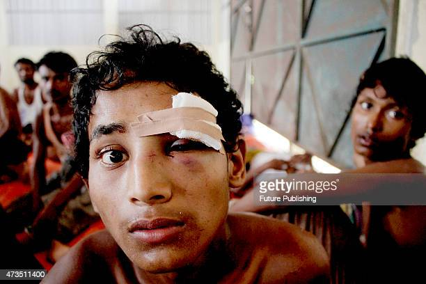A rescued Rohingya migrant seen at the new confinement on May 15 2015 in Langsa Indonesia More than 750 Rohingya and Bangladeshi migrants were...